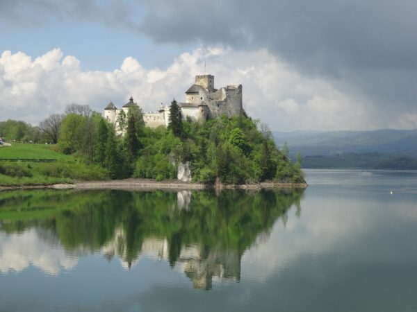 castle on a lake in poland as  a safe place to travel