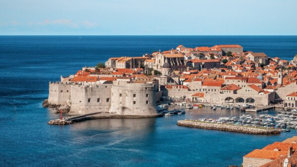 port city with stone walls and boats in croatia as  a safe place to travel