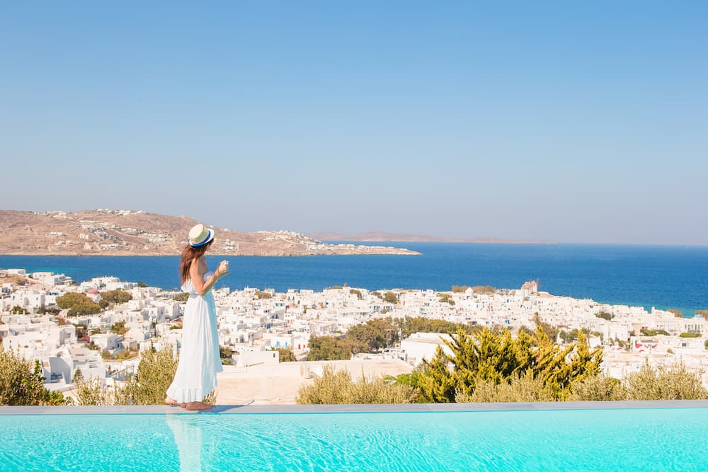 Woman enjoying her summer vacation in Mykonos - Things To Do In Mykonos​
