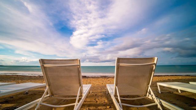 Empty white plastic sunbeds on Tsilivi Beach in summer on Zante Island, Greece